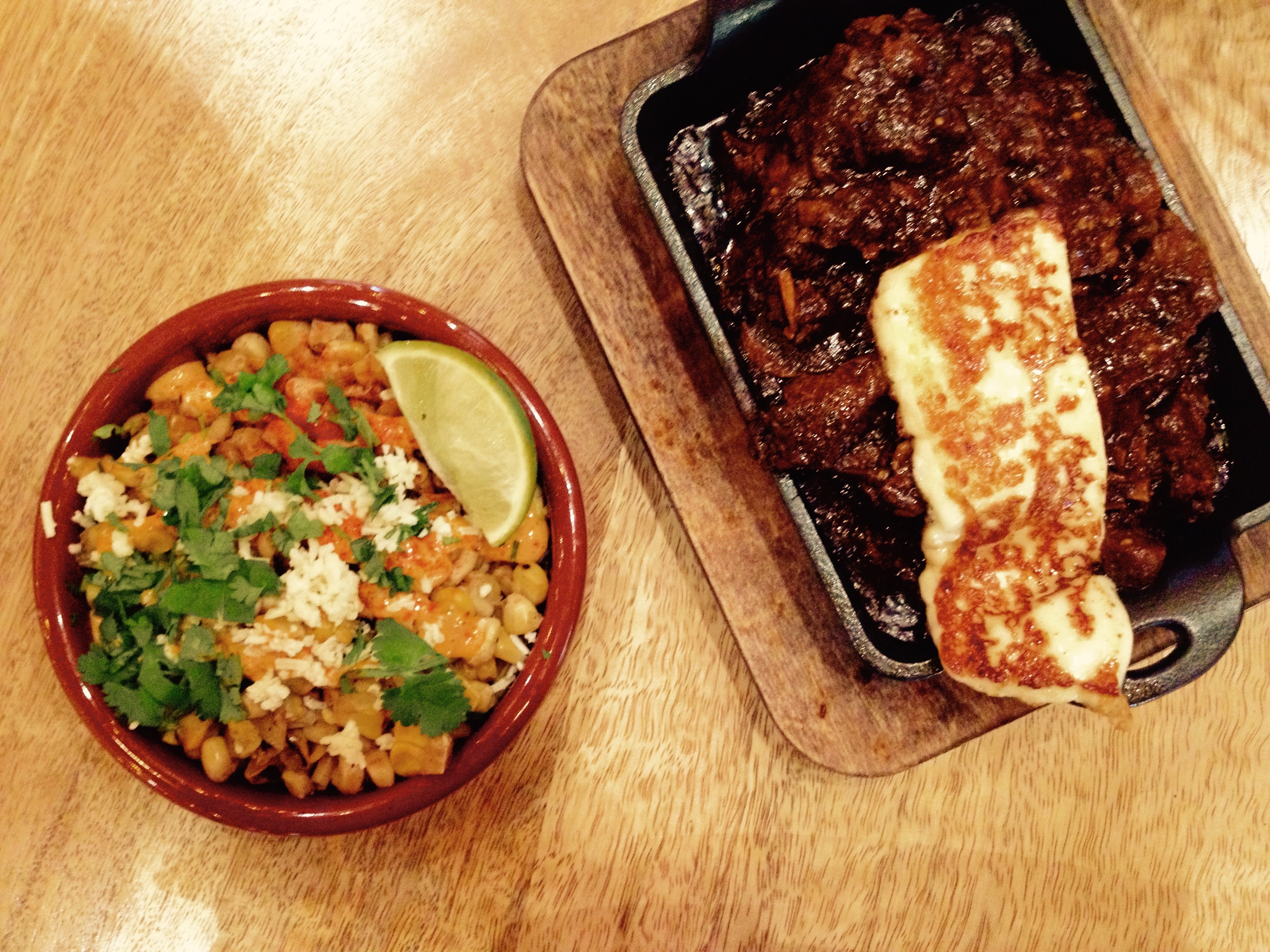 Rib-eye with pasilla chile sauce, grilled cheese and esquites.